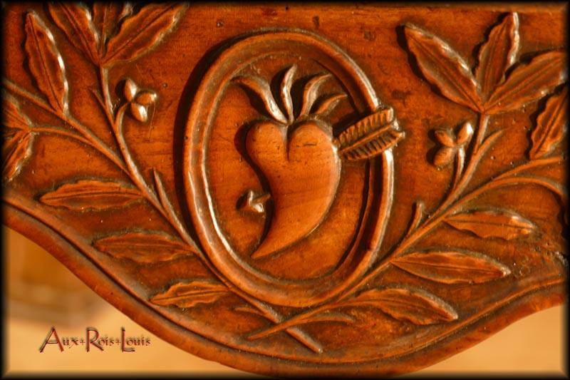 On the drawer, the heart pierced by Cupid's arrow