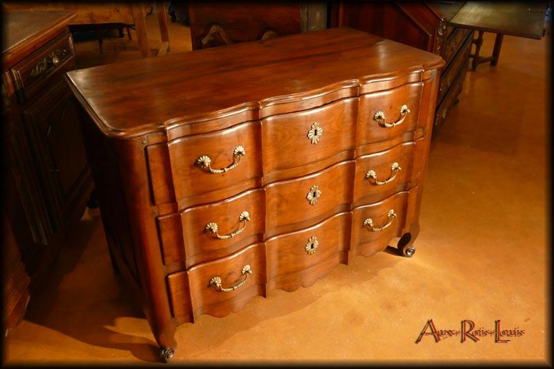 Three drawers enhanced by bronze handles