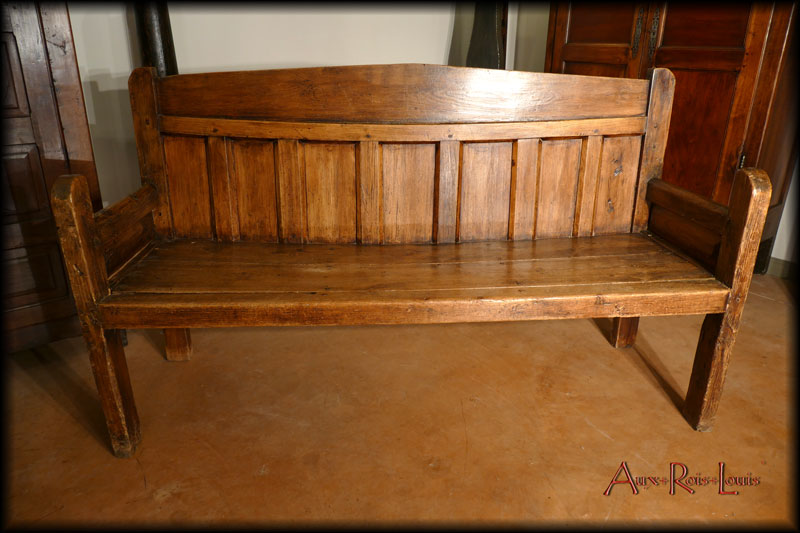 This fireplace bench is distinguished by its large size.