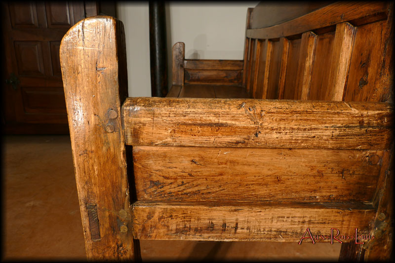 The disproportionate armrest is a pure invention of the farmer-woodworker who shaped it.