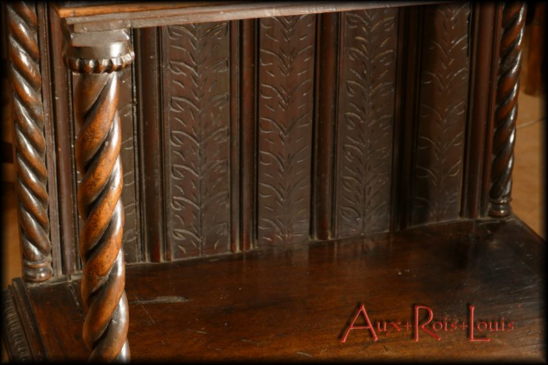 Twisted balusters and palm leaf decoration on the lower panel