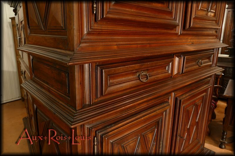 Double row of moldings around the drawers