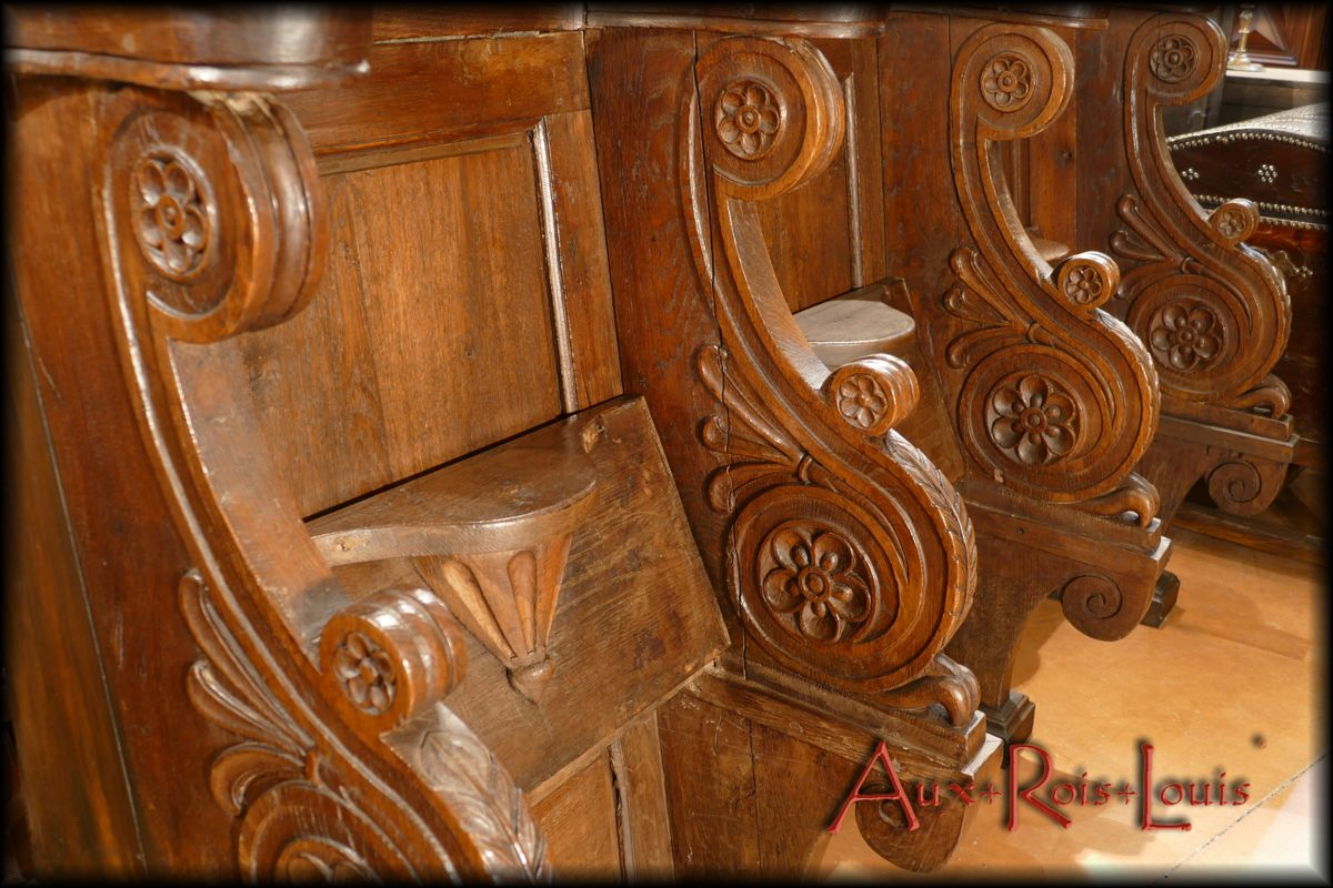 "Ornamentation of the ""parcloses"" under the armrests in passion flowers, symbols of the Passion of Christ"