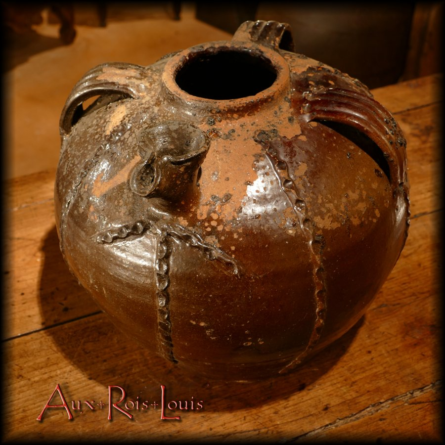 Overall, the vertical bands accentuate the pot-bellied aspect of this beautiful pottery.